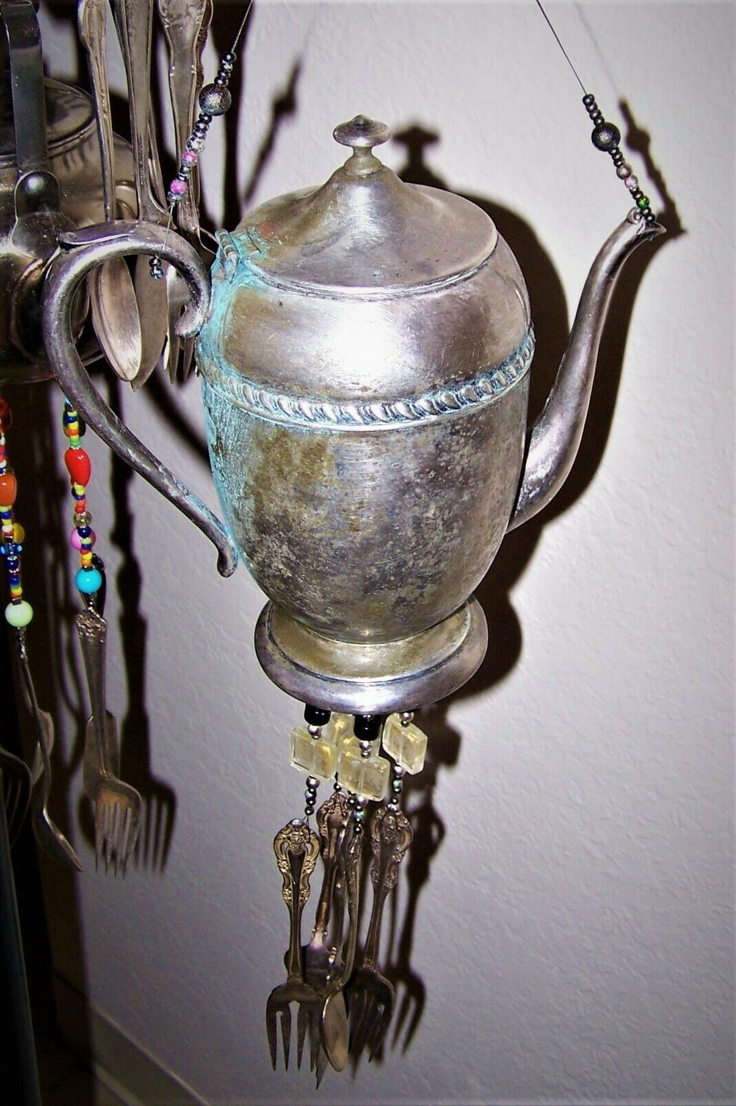 antique weathered english tea pot with silver